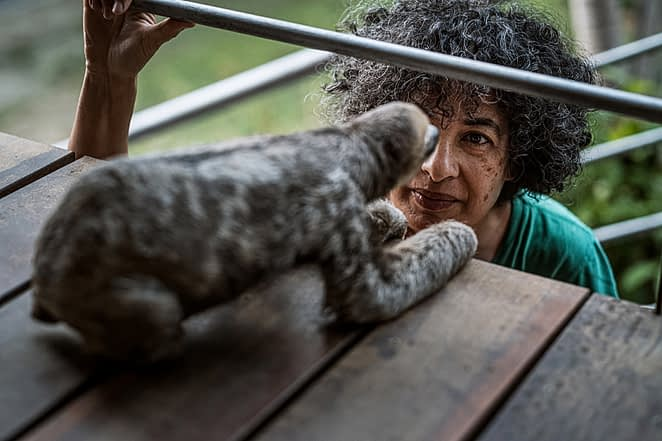 """Pool grew up in The Netherlands and moved to Suriname when she was 12 years old. She's a Surinamese national and before becoming the """"Sloth Lady"""" as many people refer to her as, she was a full-time professional translator. Suriname, 2019. Justin Mott / Kindred Guardians Project / We Animals Media"""